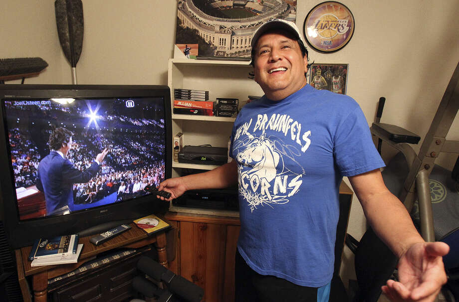 Ramon Chapa Jr. has hundreds of Joel Osteen sermon DVDs and CDs in his New Braunfels exercise room. Photo: Tom Reel / San Antonio Express-News