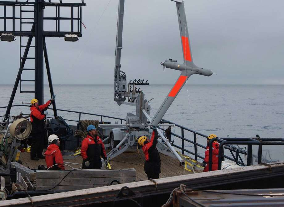 A crew last year works with an Insitu ScanEagle unmanned aerial vehicle to see how well the drone can conduct environmental surveys in Alaska's Chukchi Sea. Photo: Insitu
