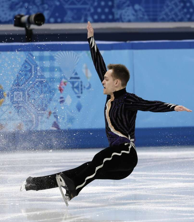 Paul Bonifacio Parkinson of Italy falls as he competes in the men's team free skate figure skating competition at the Iceberg Skating Palace during the 2014 Winter Olympics, Sunday, Feb. 9, 2014, in Sochi, Russia. (AP Photo/Bernat Armangue) Photo: Bernat Armangue, Associated Press