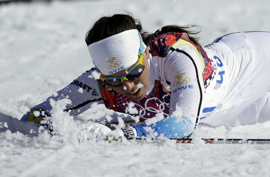 Sweden's Charlotte Kalla falls on the snow after winning the silver in the women's 10K classical-style cross-country race at the 2014 Winter Olympics, Thursday, Feb. 13, 2014, in Krasnaya Polyana, Russia. (AP Photo/Gregorio Borgia) Photo: Gregorio Borgia, Associated Press
