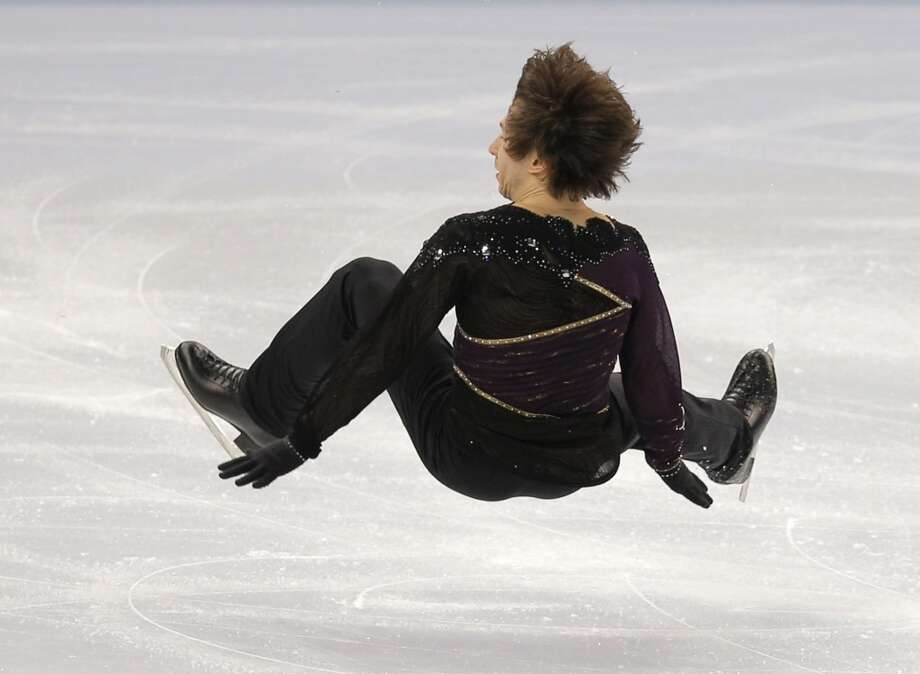 Alexei Bychenko of Israel falls as he competes in the men's free skate figure skating final at the Iceberg Skating Palace during the 2014 Winter Olympics, Friday, Feb. 14, 2014, in Sochi, Russia. (AP Photo/Vadim Ghirda) Photo: Vadim Ghirda, Associated Press