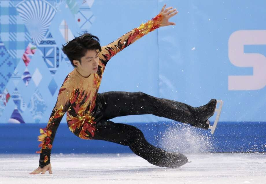 Tatsuki Machida of Japan falls as he competes in the men's free skate figure skating final at the Iceberg Skating Palace during the 2014 Winter Olympics, Friday, Feb. 14, 2014, in Sochi, Russia. (AP Photo/Bernat Armangue) Photo: Bernat Armangue, Associated Press