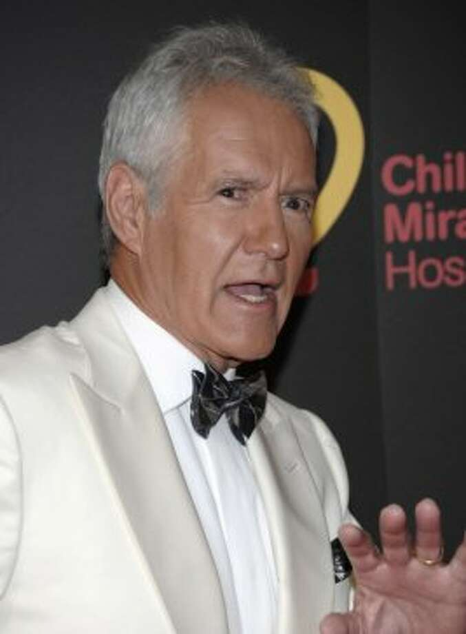 "Alex Trebek, the long-time host of ""Jeopardy!,"" injured his ankle while chasing a burglar down a hotel hallway in San Francisco in 2011. According to police, Trebek awoke to find someone rifling through his possessions in his room and ruptured his Achilles tendon giving chase to the thief. Hotel security apprehended Lucinda Moyers, 56, of San Francisco, who was booked on suspicion of burglary and receiving stolen property. Photo: Dan Steinberg, Associated Press"