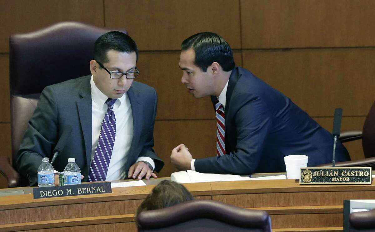 San Antonio Mayor Julián Castro (right) talks with Councilman Diego Bernal at a City Council session. Some wonder if Castro's
