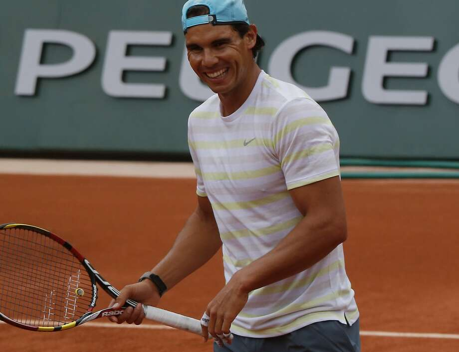 Rafael Nadal is the top seed in the French Open, which begins Sunday. Photo: Bertrand Combaldieu, Associated Press