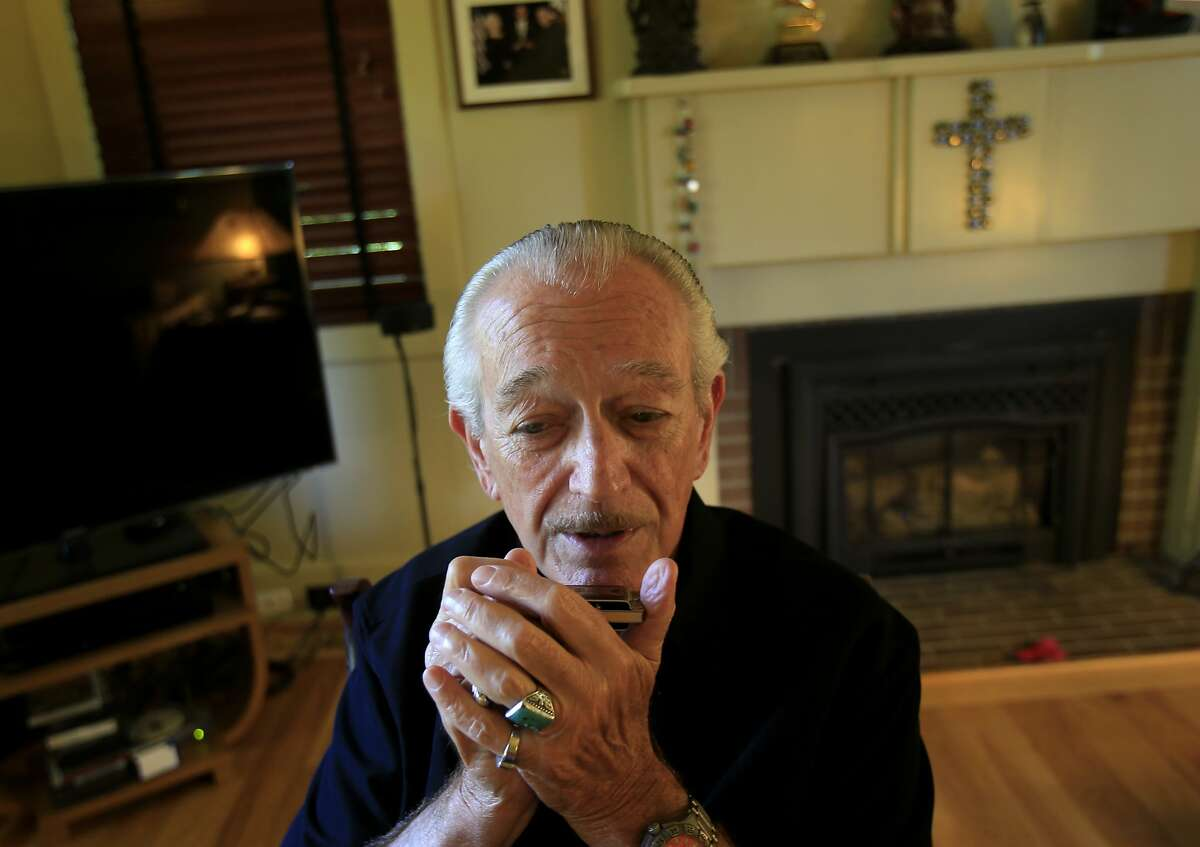 Charlie Musselwhite looked up from practicing his A chord harp in the living room of his home Thursday May 22, 2014. Blues great Charlie Musselwhite is anchoring the upcoming Healdsburg Jazz Festival.