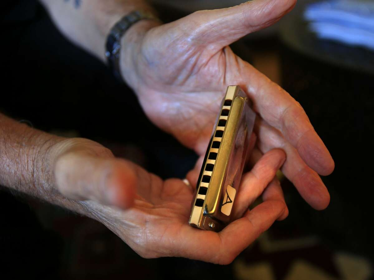 Charlie Musselwhite holds one of his Seydel harmonicas at his home Thursday May 22, 2014. Blues great Charlie Musselwhite is anchoring the upcoming Healdsburg Jazz Festival.