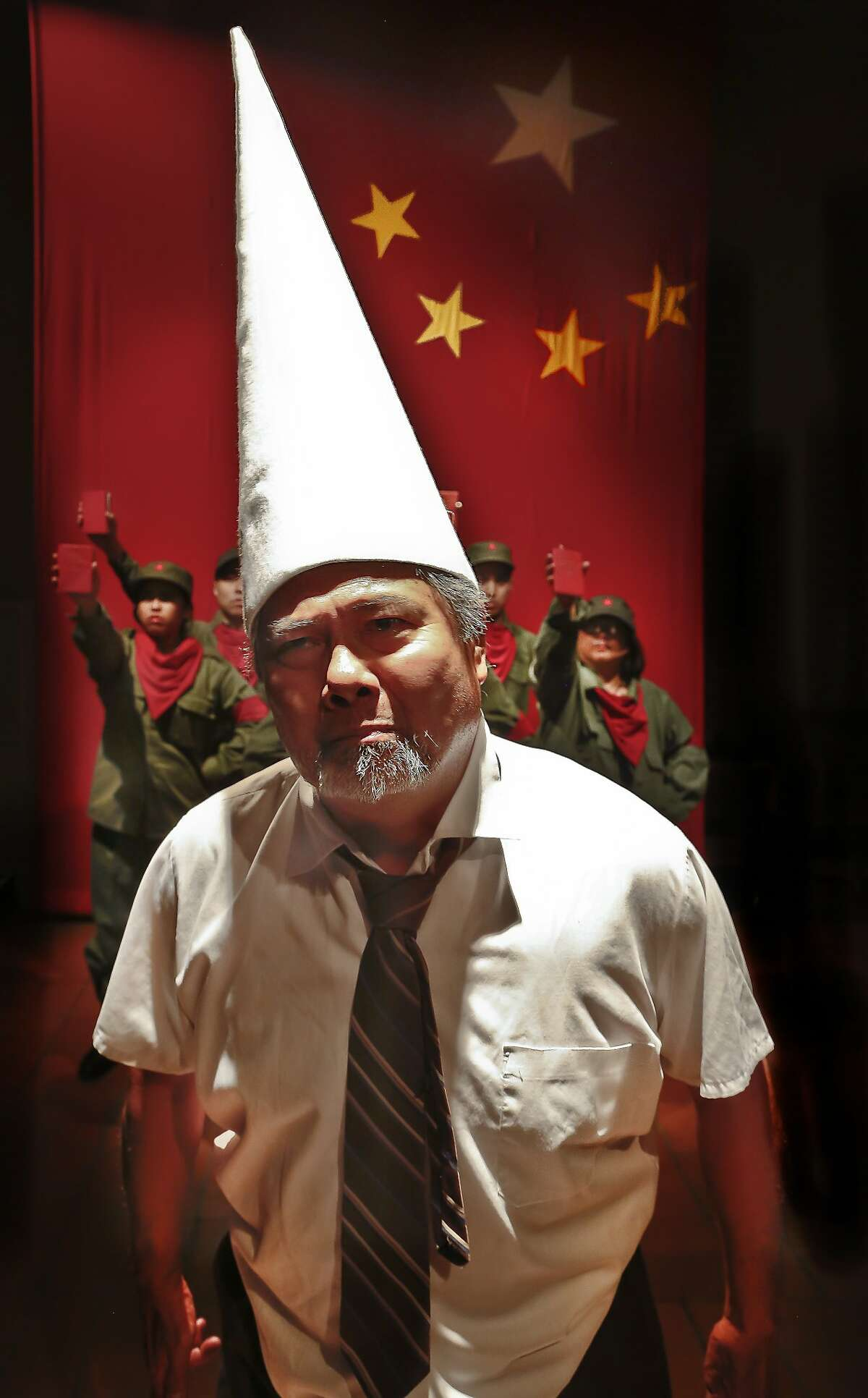 """Randall Nakano as Professor Yang being humiliated by the Red Guards in """"The Crazed"""" at Central Works"""