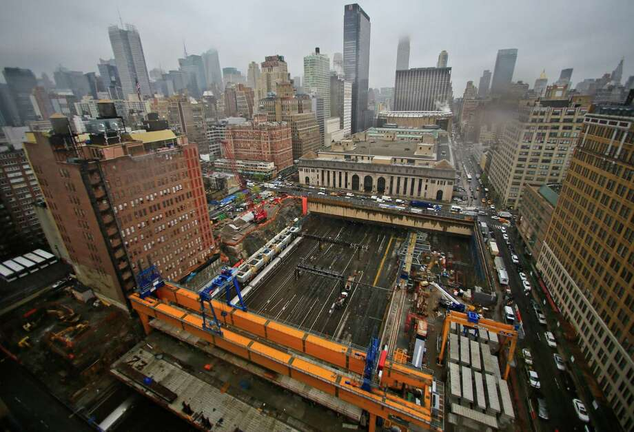"""CORRECTS LOCATION OF THE LAUNCHER -This photo shows ongoing construction of  Brookfield Manhattan West project site over rail tracks used by commuter trains at Penn Station, Wednesday April 16, 2014 in New York.  A giant crane called """"The Launcher,"""" a $7 million Italian-designed crane, spans the width of the tracks between 33rd Street and 32nd Street and will lift 16 bridge-like concrete spans into a $300 million platform completely covering the tracks. (AP Photo/Bebeto Matthews) ORG XMIT: NYBM407 Photo: Bebeto Matthews / AP"""