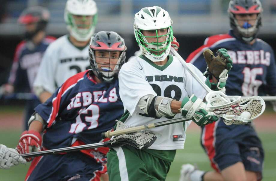 New Fairfield's John Gephart (13) tries to steal the ball from New Milford's Jameson Steinhardt (28) in New Milford's 13-7 win over New Fairfield in the high school boys lacrosse game at Brookfield High School in Brookfield, Conn. Friday, May 23, 2014. Photo: Tyler Sizemore / The News-Times