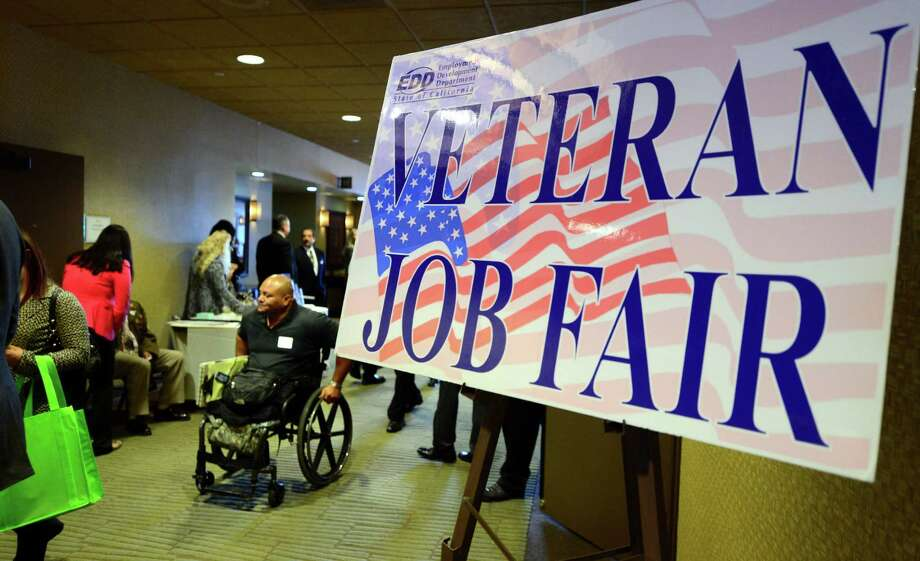 "Anthony Teasley, a veteran of nine years in the Marines only to have lost his legs when he finished in an auto accident, attends the annual ""Honor a Hero - Hire a Vet"" job resource fair in Van Nuys, California, on October 24, 2013. The US jobless rate fell to 7.2 percent in September from 7.3 percent the month before, but job creation remained sluggish, the Labor Department reported on October 22. AFP PHOTO/Frederic J. BROWNFREDERIC J. BROWN/AFP/Getty Images Photo: FREDERIC J. BROWN, Staff / AFP"