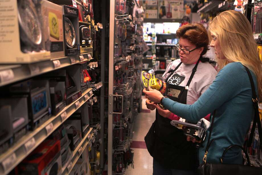 Heather Borstel (left) helps customer Charlotte Ferguson find hardware supplies at the Standard 5 and 10. Photo: Kevin N. Hume, The Chronicle