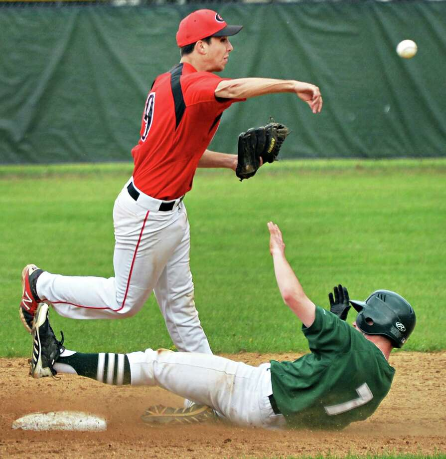 Shen's #7 Josh Hayner, bottom, is out at second but breaks up the double play throw by Guilderland's #9 Jacob Sturn in the Class AA quarterfinal game Friday May 23, 2014, 2014, in Clifton Park, NY.  (John Carl D'Annibale / Times Union) Photo: John Carl D'Annibale / 00027011A