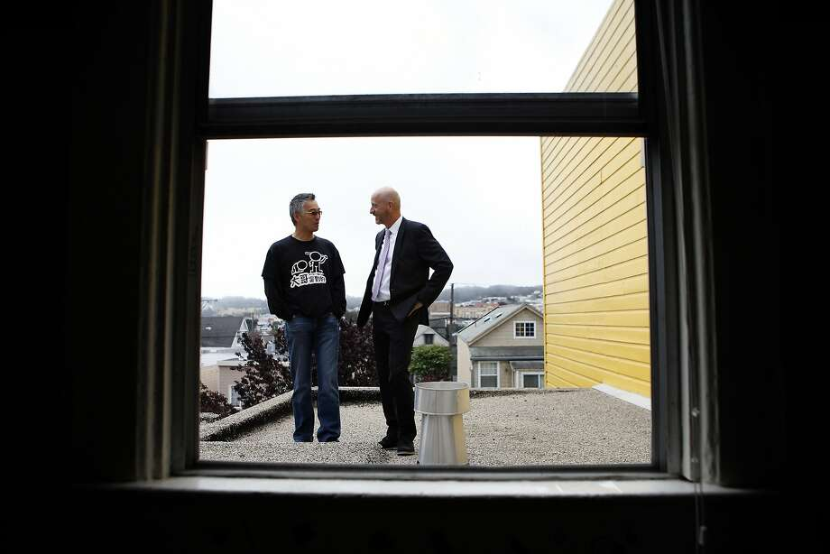 "Anders Fong (left) talks to Frank Castaldini of Coldwell Banker Real Estate, who says, ""If you can't buy a house for a million dollars in Bernal Heights anymore - and it's really hard - where are you going to go?"" Photo: Michael Short"