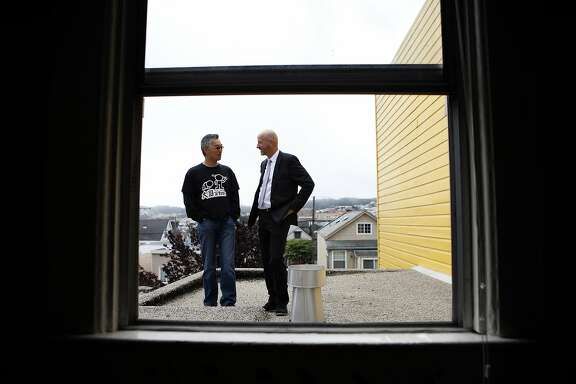 While standing on a second story deck area, Broker Frank Castaldini, right, talks with his client Anders Fong about renovation plans for the Bernal Heights property Anders recently closed on in San Francisco, CA, Friday May 23, 2014.