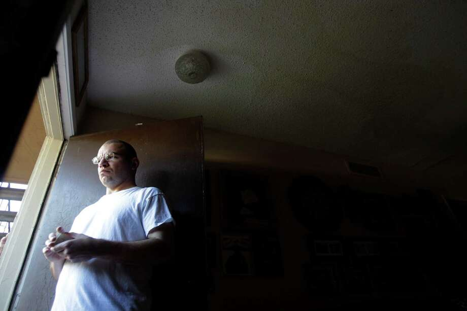 Edward Morales and his wife and kids have a constant pipe leak in their living room at the Sandridge Apartments in Pasadena. Photo: Mayra Beltran, Staff / © 2014 Houston Chronicle