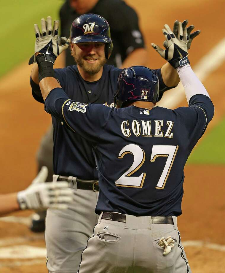 MIAMI, FL - MAY 23:  Mark Reynolds #7 of the Milwaukee Brewers is congratulated by Carlos Gomez #27 after hitting a two run home run during a game against the Miami Marlins at Marlins Park on May 23, 2014 in Miami, Florida.  (Photo by Mike Ehrmann/Getty Images) ORG XMIT: 477583629 Photo: Mike Ehrmann / 2014 Getty Images
