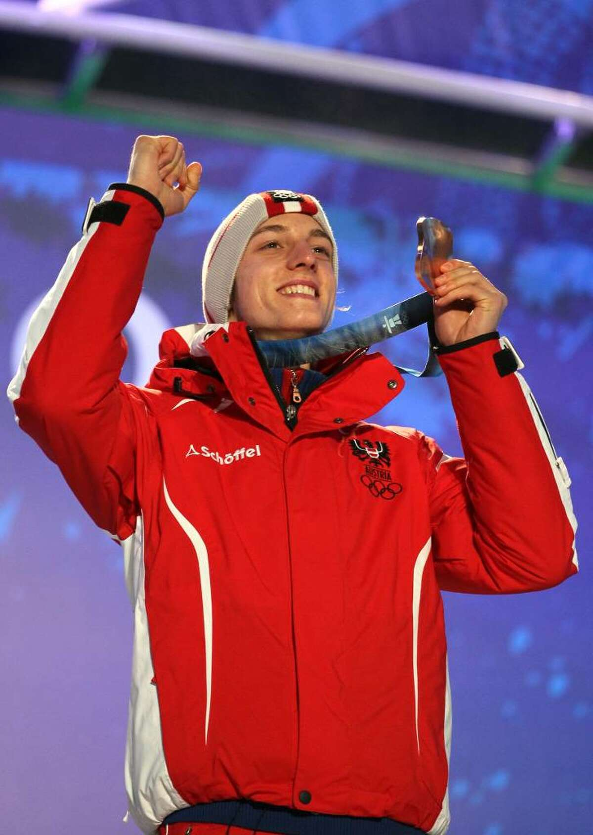 WHISTLER, BC - FEBRUARY 13: Bronze medalist Gregor Schlierenzauer of Austria celebrates with his medal during the Medal Ceremony for the Ski Jumping Normal Hill Individual on day 2 of the Vancouver 2010 Winter Olympics at Whistler Medals Plaza on February 13, 2010 in Whistler, Canada. (Photo by Al Bello/Getty Images) *** Local Caption *** Gregor Schlierenzauer