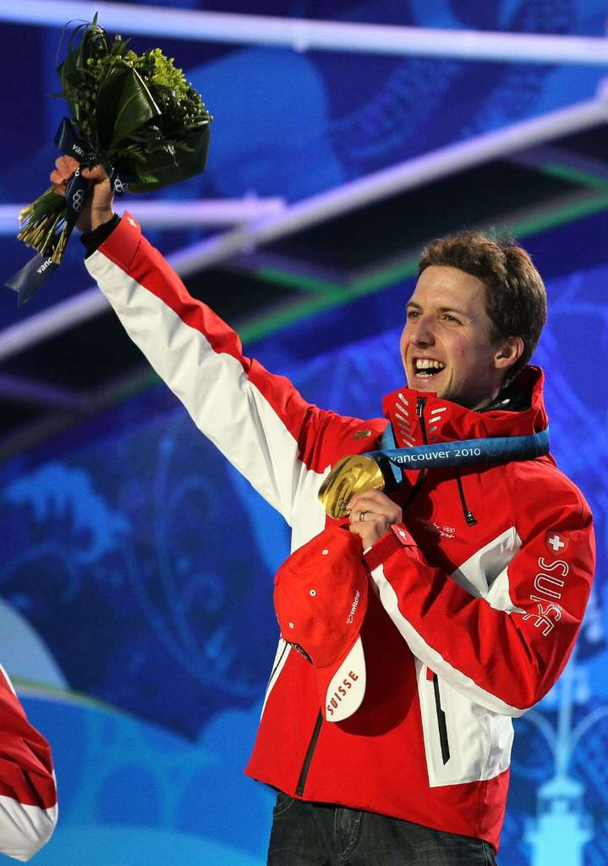WHISTLER, BC - FEBRUARY 13: Simon Ammann of Switzerland celebrates with his gold medal during the Medal Ceremony for the Ski Jumping Normal Hill Individual on day 2 of the Vancouver 2010 Winter Olympics at Whistler Medals Plaza on February 13, 2010 in Whistler, Canada. (Photo by Al Bello/Getty Images) *** Local Caption *** Simon Ammann