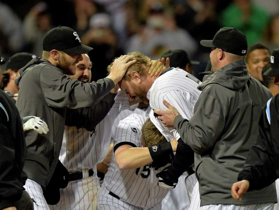 CHICAGO - IL, MAY 23:  Chris Sale #49 (L-R), Adam Eaton #1 and Gordon Beckham #15 of the Chicago White Sox celebrates with teammate Adam Dunn #44 after Dunn hit a two-run, game winning home run scoring Moises Sierra during the ninth inning against the New York Yankees at U.S. Cellular Field on May 23, 2014 in Chicago, Illinois. The White Sox defeated the Yankees 6-5.  (Photo by Brian Kersey/Getty Images) ORG XMIT: 477583609 Photo: Brian Kersey / 2014 Getty Images