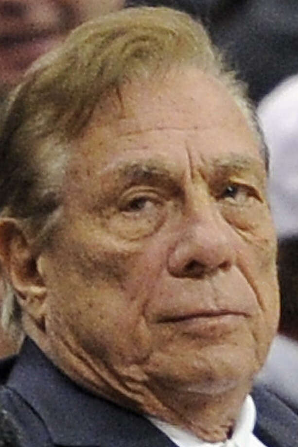 Clippers owner Donald Sterling will turn over the team to his estranged wife, who will sell it, a source says. / AP