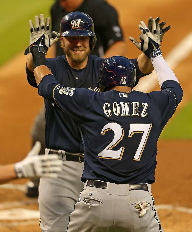 MIAMI, FL - MAY 23:  Mark Reynolds #7 of the Milwaukee Brewers is congratulated by Carlos Gomez #27 after hitting a two run home run during a game against the Miami Marlins at Marlins Park on May 23, 2014 in Miami, Florida.  (Photo by Mike Ehrmann/Getty Images) Photo: Mike Ehrmann, Getty Images