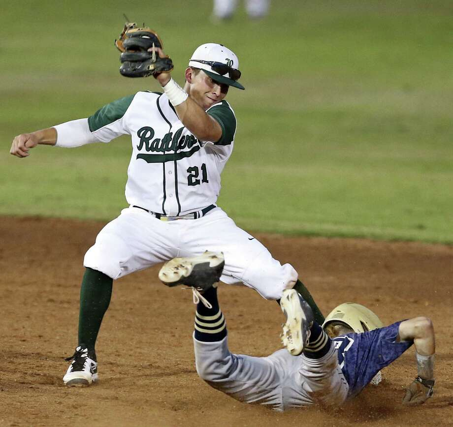 Laredo Alexander's Gabe Sanchez steals second by beating the throw to Reagan's Andres Sosa in Game 2 of their Region IV-5A series at Wolff Stadium. Photo: Edward A. Ornelas / San Antonio Express-News / © 2014 San Antonio Express-News