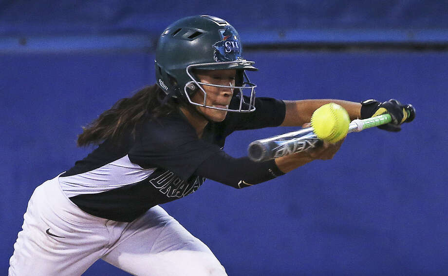 Southwest shortstop Kristal Salinas tries to bunt and get a runner to score from third base during a 7-3 victory over San Marcos on Friday. Photo: Tom Reel / San Antonio Express-News