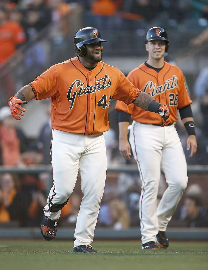 Pablo Sandoval (left) smiles after his three-run homer in the first, which scored Buster Posey, who reached on a grounder that the Twins failed to turn into a double play. Photo: Tony Avelar, Associated Press