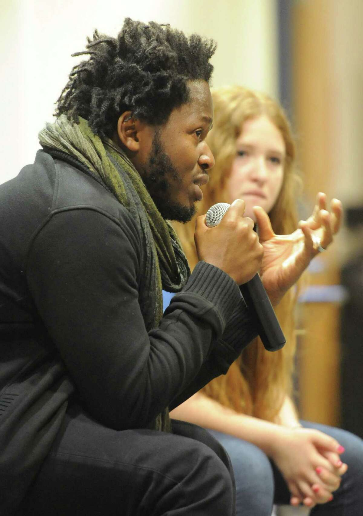 Keynote speaker Ishmael Beah and Newtown High School student activist Sarah Clements speak during the story exchange at the Honor With Action Youth Leadership Summit on Gun Violence Prevention at Newtown High School in Newtown, Conn. Saturday, May 24, 2014. The summit featured keynote speaker Ishmael Beah, a Sierra Leonean best-selling author and human rights activist. The event included many large group activities and small workshops such as story exchange, a young activist panel, a movie about Virginia Tech shooting survivor Colin Goddard, healing through the arts, and breakout sessions about spirituality and mental health. About 100 children from across the state and Harlem, N.Y. attended the summit.