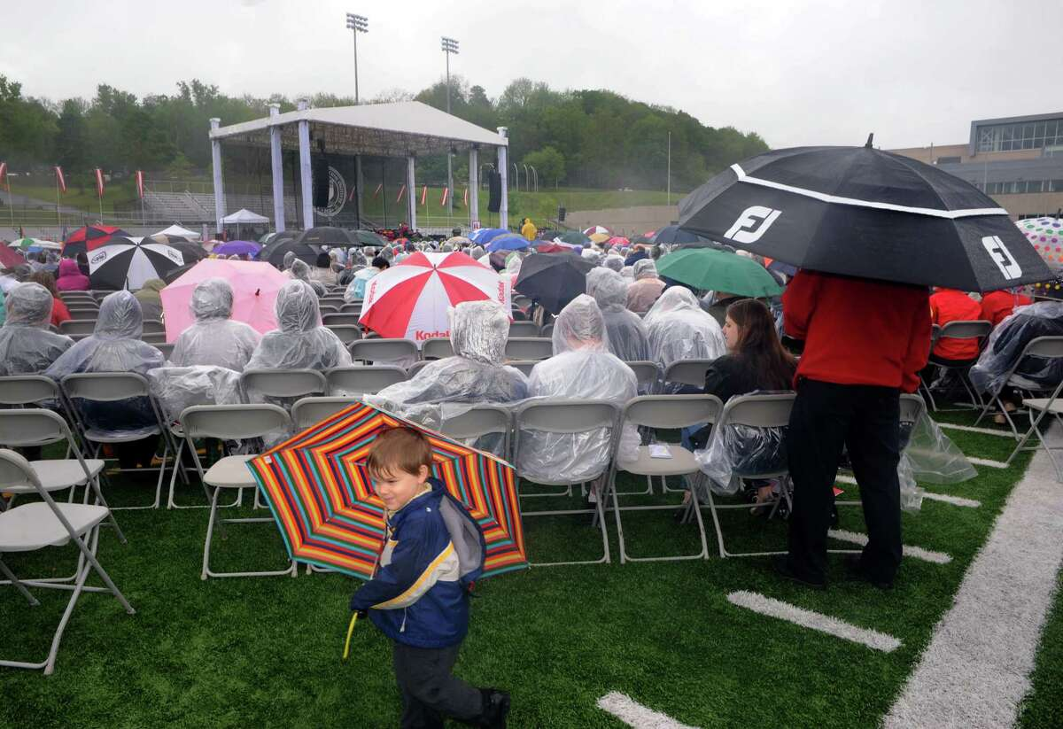 Three-year-old Caleb Brooks, whose father James Brooks was recieving a Phd., wanders around under umbrella cover during the Rensselaer Polytechnic Institutes 208th commencement on Saturday May 24, 2014 in Troy, N.Y. (Michael P. Farrell/Times Union)