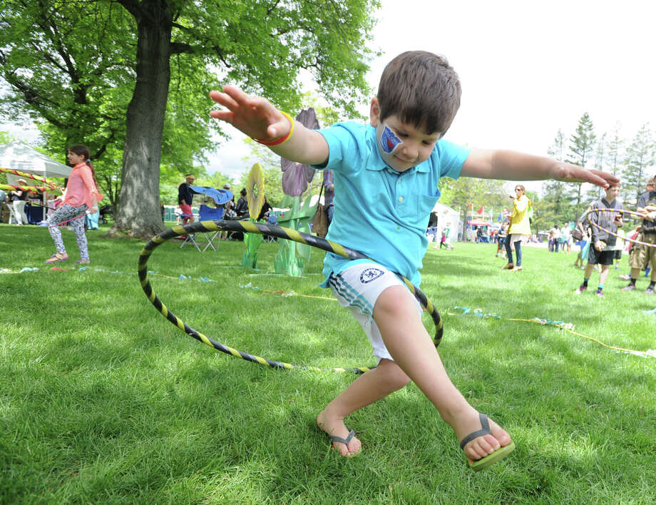 Thomas Bonomo, 6, of Greenwich, has fun with a hoop during the Greenwich Town Party at Roger Sherman Baldwin Park, Greenwich, Conn., Saturday, May 24, 2014. Photo: Bob Luckey / Greenwich Time