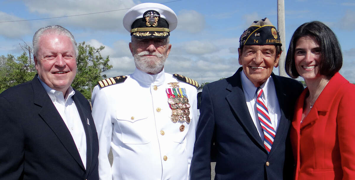 First Selectman MichaelTetreau, Capt. Roger Crossland, USNR (Retired), Ray Longden, Navy (Retired) and Selectman Cristin McCarthy Vahey at the annual Sea Memorial Service at South Benson Marina on Saturday.