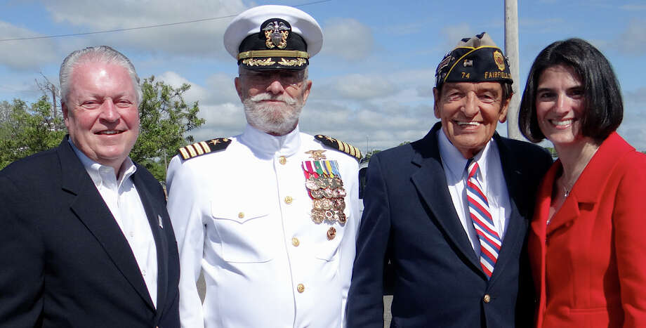 First Selectman MichaelTetreau, Capt. Roger Crossland, USNR (Retired), Ray Longden, Navy (Retired) and Selectman Cristin McCarthy Vahey at the annual Sea Memorial Service at South Benson Marina on Saturday. Photo: Mike Lauterborn / Fairfield Citizen