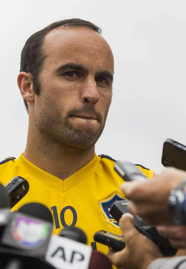 Los Angeles Galaxy forward Landon Donovan talks to media after a soccer training session at StubHub Center in Carson, Calif., Saturday, May 24, 2014.  Donovan, the most accomplished American player in the history of men's soccer, won't be going to his fourth World Cup. The 32-year-old attacker was among seven players cut Thursday when coach Jurgen Klinsmann got down to the 23-man limit well before the June 2 deadline. (AP Photo/Ringo H.W. Chiu) Photo: Ringo H.W. Chiu, Associated Press