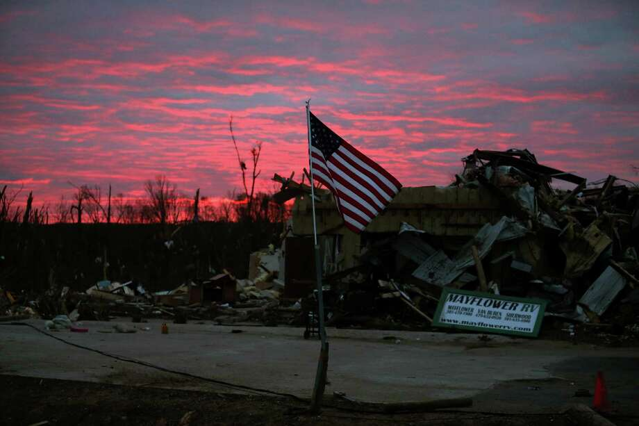 MAYFLOWER, AR - APRIL 30:  The sun rises behind a business that was destroyed by a tornado last Sunday, on April 30, 2014 in Mayflower, Arkansas. Late last Sunday afternoon, a number of deadly tornadoes ripped through the region leaving more than a dozen dead.  (Photo by Mark Wilson/Getty Images) ORG XMIT: 487836363 Photo: Mark Wilson / 2014 Getty Images
