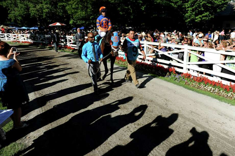 Overanalyze with Javier Castellano parade through the paddock before the 29th Running of The Foxwoods King's Bishop Saturday, Aug. 24, 2013, at Saratoga Race Course in Saratoga Springs, N.Y. (Cindy Schultz / Times Union archive) Photo: Cindy Schultz / 00023621A