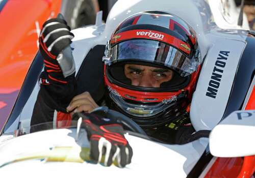 Juan Pablo Montoya, of Colombia, puts on his gloves as he prepares to drive on the final day of practice for the Indianapolis 500 IndyCar auto race at the Indianapolis Motor Speedway in Indianapolis, Friday, May 23, 2014. The 98th running of the Indianapolis 500 is Sunday. (AP Photo/Michael Conroy) Photo: Michael Conroy, Associated Press / AP