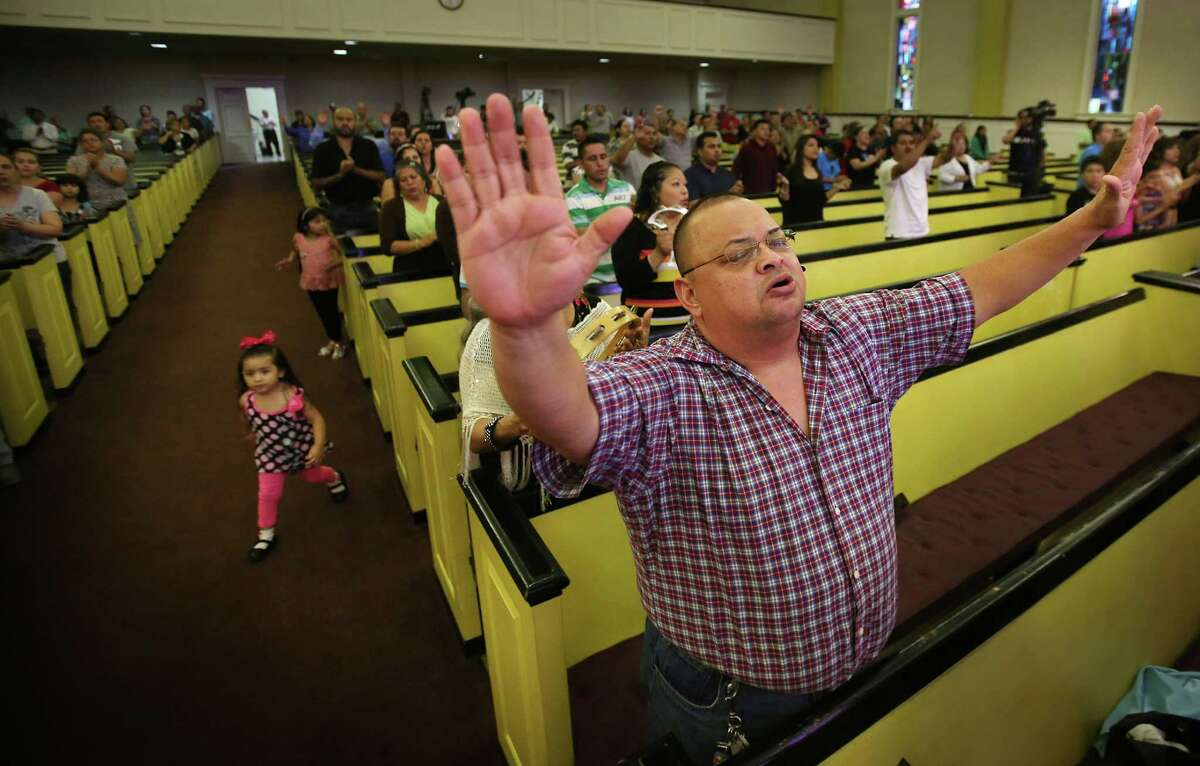 Guillermo Berffer joins the congregation in worship during a weekday Spanish service at La Iglesia Del Pueblo on May 21, 2014, in Pasadena, Tx. La Iglesia Del Pueblo, a non-denominational spanish-language church, is launching an english-language service.