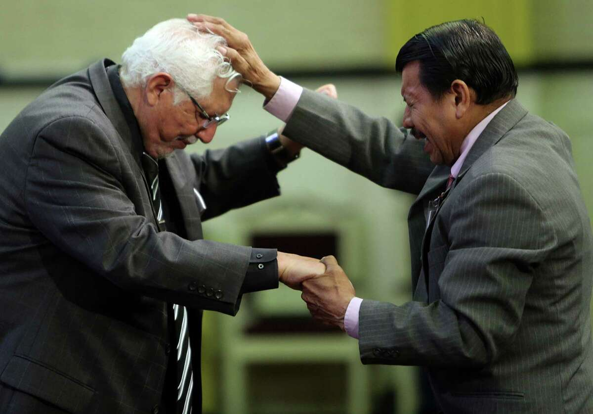 Pastor Roberto Ruben Villarreal is blessed by elder Andres Salmeron during a Spanish service at La Iglesia Del Pueblo on May 21, 2014, in Pasadena, Tx. La Iglesia Del Pueblo, a non-denominational spanish-language church, is launching an english-language service.