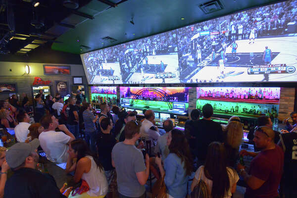 Fans watch game two of the NBA's Western Conference Finals in the Australian-themed Roo Pub at Redland Rd. and 281. Behind the bar is a model of the famed Sydney harbor bridge.