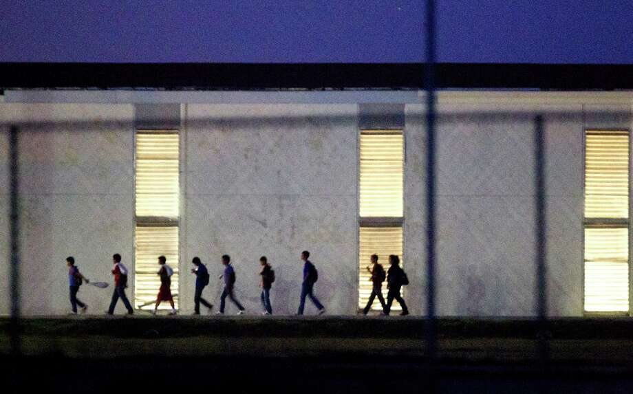 Immigrant children who come into the U.S. alone are housed in shelters like this one in Harlingen, which is licensed to hold up to 295. Some 60,000 children and teens are expected to be caught in the U.S. illegally without a parent or guardian this year. Photo: Johnny Hanson, Staff / © 2014  Houston Chronicle