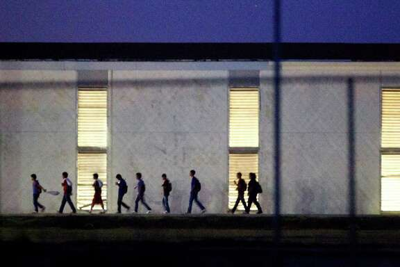Immigrant children who come into the U.S. alone are housed in shelters like this one in Harlingen, which is licensed to hold up to 295. Some 60,000 children and teens are expected to be caught in the U.S. illegally without a parent or guardian this year.