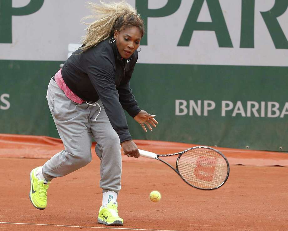 Top-ranked Serena Williams, practicing ahead of today's first-round match against Alize Lim, is 53-2 with eight titles on clay since 2012. Photo: Michel Euler / Associated Press / AP