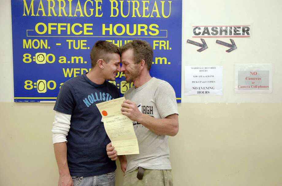 William Roletter (left) and Paul Rowe on Wednesday after having their photo made for their newly acquired marriage certificate at City Hall in Philadelphia. On Tuesday, Pennsylvania became the final Northeastern state and the 19th in the U.S. to legalize same-sex marriage. Photo: Matt Rourke / Associated Press / AP