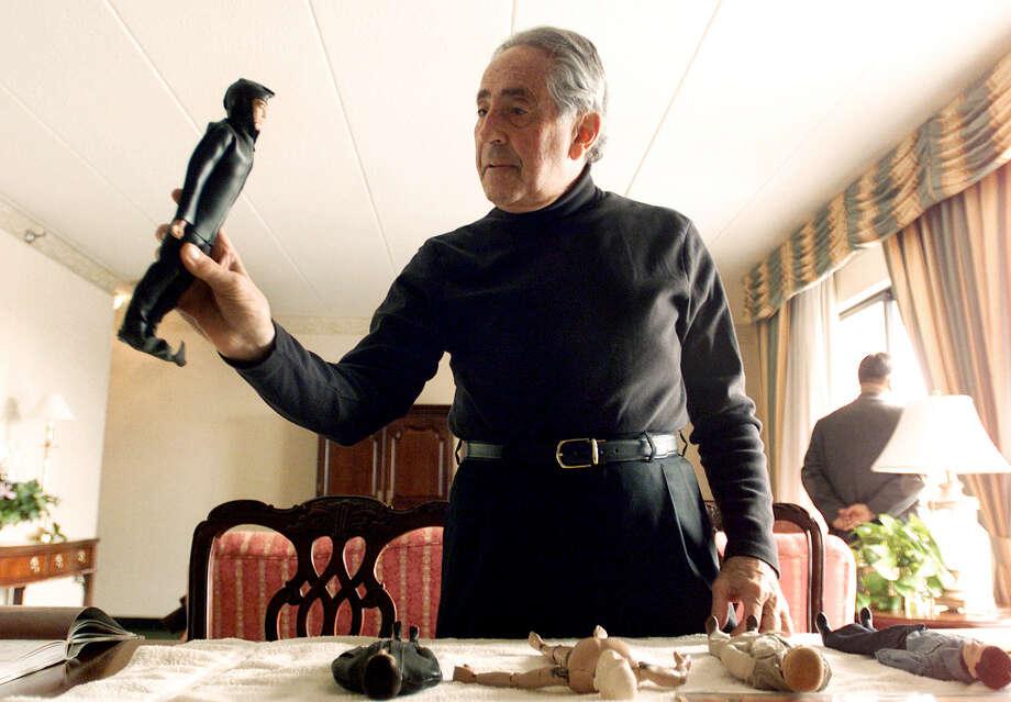 G.I. Joe creator Don Levine holds his original scuba diver G.I. Joe above other orginal prototypes. Photo: Associated Press / AP
