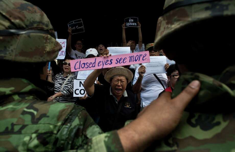 Thai soldiers block anti-coup protesters in Bangkok. The nearly 200 political officials already detained include former Prime Minister Yingluck Shinawatra. Photo: Manan Vatsyayana / Getty Images / AFP