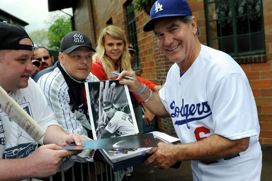 Steve Garvey, formerly of the Los Angeles Dogders, holds up a fan's photo of him while he signs autographs for fans before the sixth annual Hall of Fame Classic baseball game on Saturday, May 24, 2014, at Doubleday Field in Cooperstown, N.Y. (Cindy Schultz / Times Union) Photo: Cindy Schultz / 00027031A