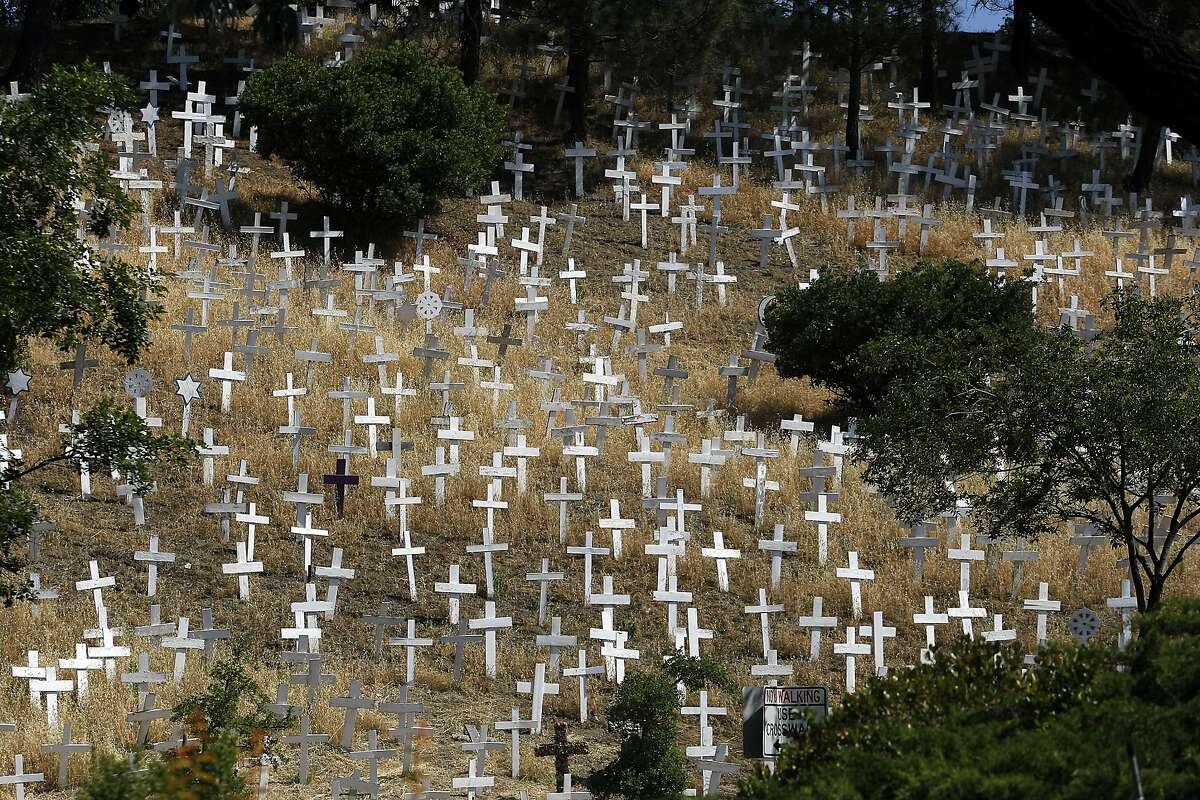 The Crosses of Lafayette war memorial covers a hillside next to the Lafayette BART station in Lafayette, CA, Wednesday May 21, 2014.