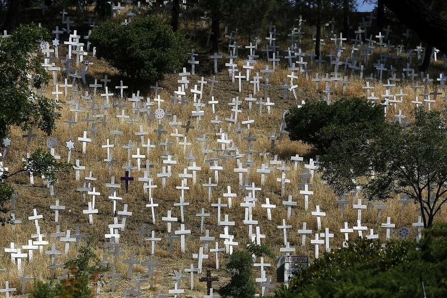 The Crosses of Lafayette memorial stands on a hillside above Highway 24 and the Lafayette BART Station. Photo: Michael Short
